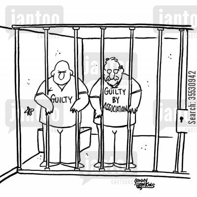 Two men in jail: One wearing shirt with 'Guilty', the other with 'Guilty by Association'.
